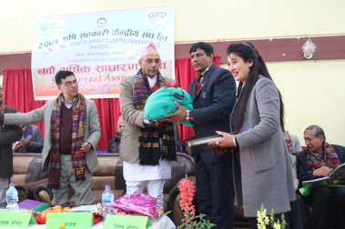 The Chairman of NACCFL presenting the first Kisan Ko Poko subscription share to the Minister of Ministry of Cooperatives and Poverty Alleviation in Nepal on January 11, 2017.